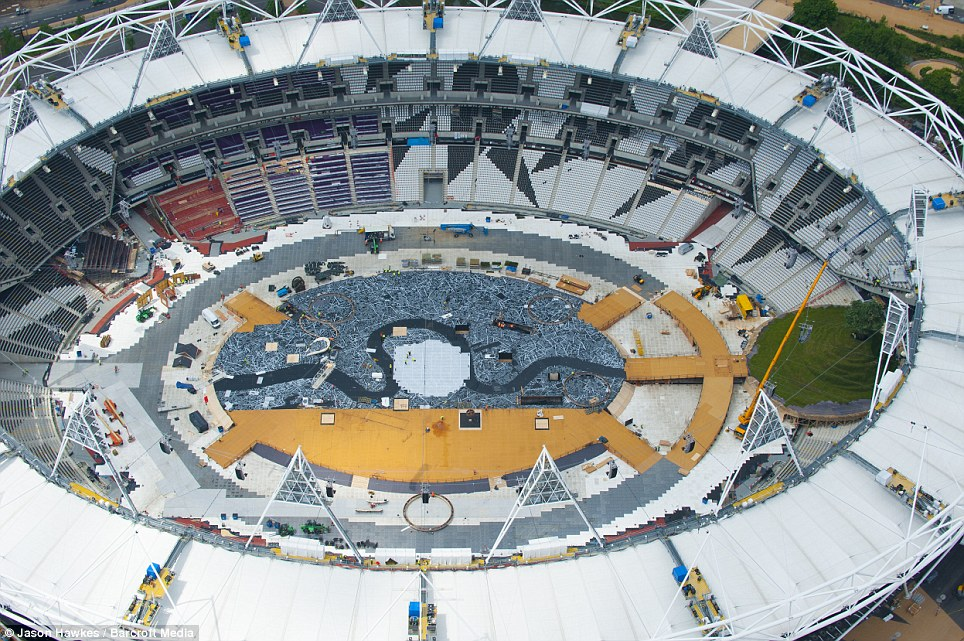 The photographs show the preparations that are underway in haste for the Olympic opening ceremony happening next month