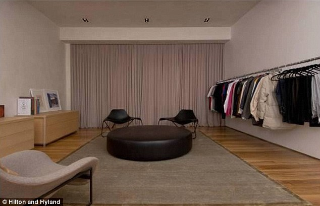 In-house boutique: Kanye has eight-feet high racks to hold his trainers