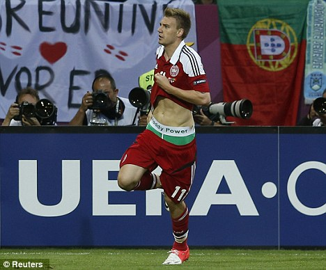 Display: Nicklas Bendtner pulled up his shirt to reveal Paddy Power pants