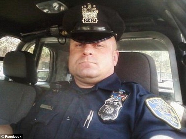 Gunman: Off-duty officer Richard Klementovich, pictured, is barricaded inside the house of his estranged wife and has been shooting at police