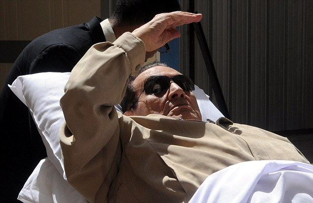 Former Egyptian President Hosni Mubarak arrived for his trial in Cairo, Egypt, lying in a hospital bed earlier this month because of his poor health