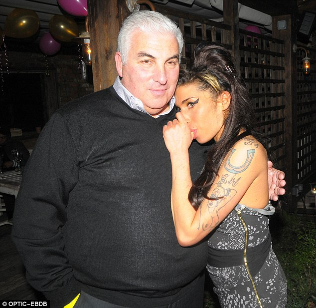 'Give me a cuddle': Daddy's girl Amy with her father Mitch in 2010