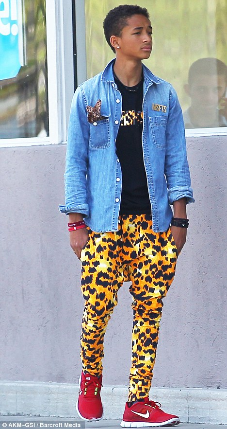 Taking a walk on the wild side: Willow's brother Jaden emerged wearing leopard print trousers in Canoga Park, California over the weekend