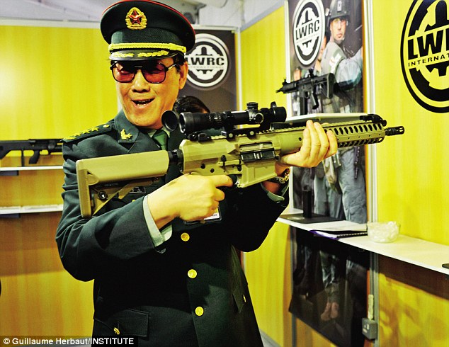 Chinese People's Liberation Army officer tests an American rifle