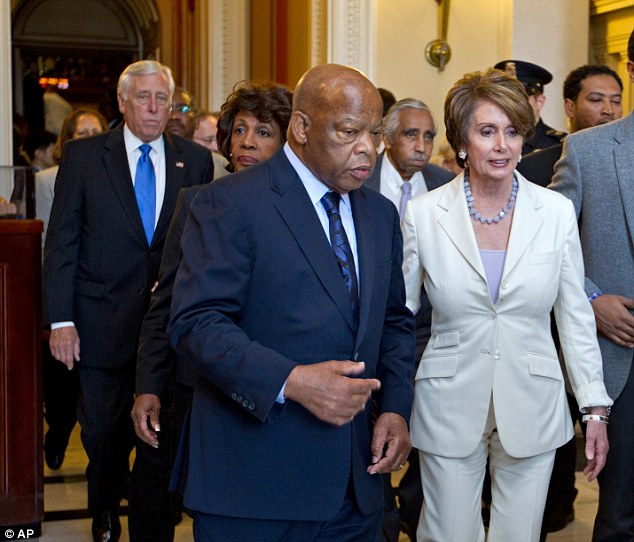From left, House Minority Whip Steny Hoyer and House Minority Leader Nancy Pelosi right, and many House Democrats walk out of the Capitol during the vote to hold Attorney General Eric Holder in contempt