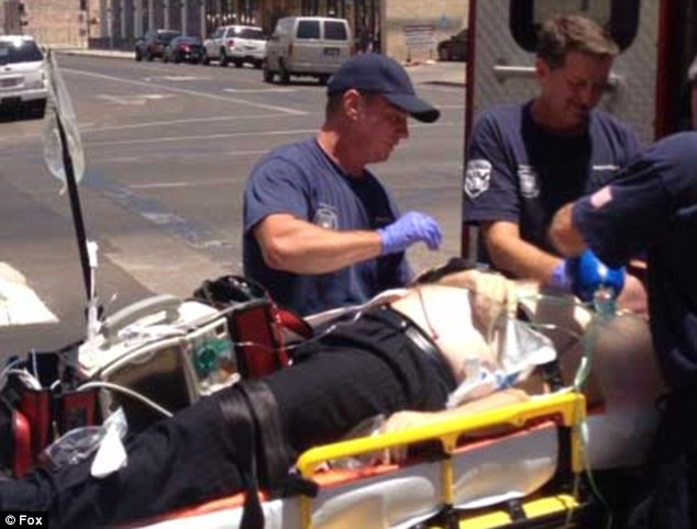 Emergency: The 53-year-old was stretchered out of the court in Phoenix minutes later but died in hospital