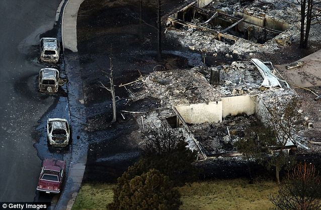 Widespread: Homes and cars were destroyed by the Waldo Canyon fire in Colorado Springs, Colorado