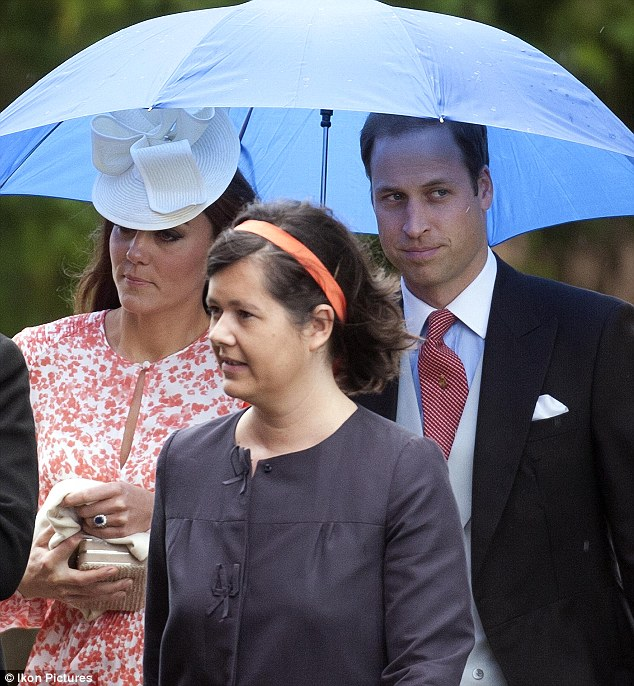 Feeling awkward? William and Kate look out from under an umbrella at a wedding attended by no fewer than four of their former partners