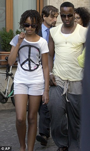 Summer fun: Malia leaves the Giolitti Ice Cream parlour in Rome with a bodyguard on July 8, 2009
