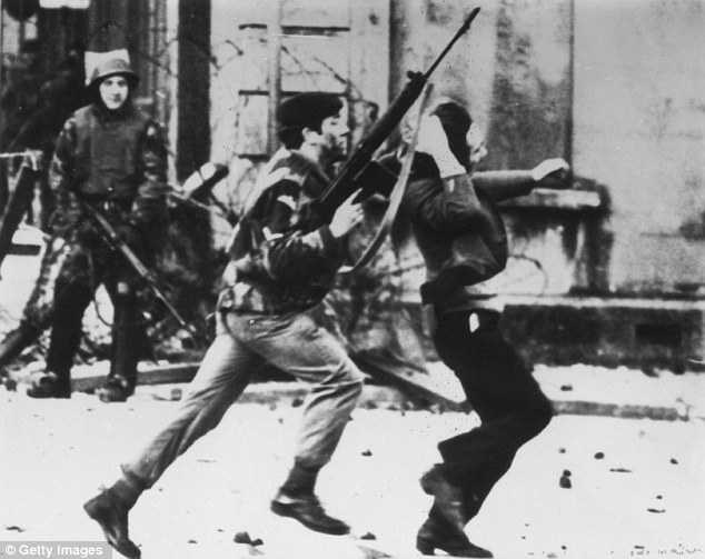 An armed soldier attacks a protestor on Bloody Sunday when British Paratroopers shot dead 13 civilians on a civil rights march in Derry