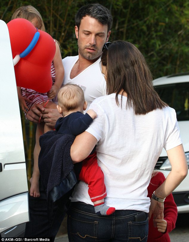 Family fun: Samuel joined his parents and sisters at a Fourth of July parade