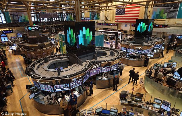 Dependent: The rates set by Libor are an integral part of the world financial system, including the New York Stock Exchange (pictured), and are used to price some $550trillion in loans, securities and derivatives