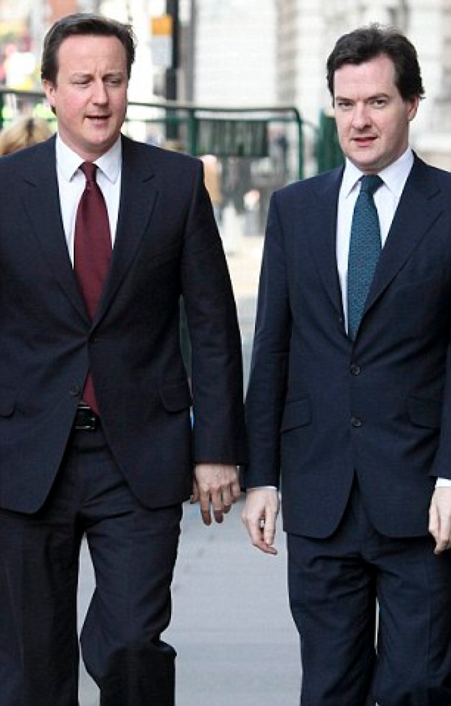Conservative Party leaderThe Rt Hon David Cameron MP arriving to make a speech on solving the Labour's debt crisis in Westminster this morning walking with Shadow chancellor George Osborne MP (right)