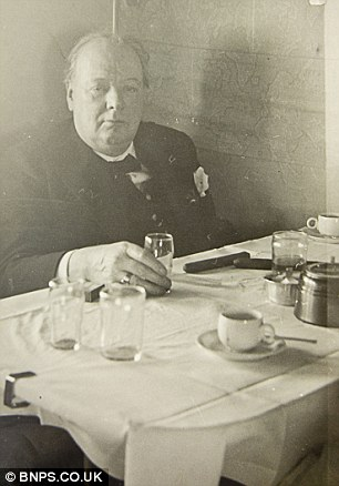 Churchill (seen here dining on board a plane) could have been killed by the lethal chocolate