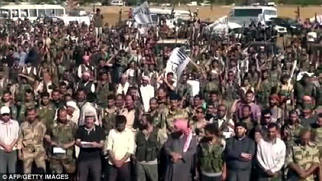Rebels: This image taken from YouTube allegedly shows members of the Free Syrian Army dictating a message to forces loyal to President Bashar al-Assad in Aleppo