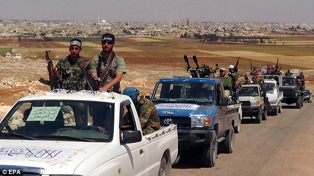 Attacks: News of the helicopter attacks emerged as Syrian rebels launched an offensive to 'liberate' the country's largest city of Aleppo. Syrian rebels are seen patrolling on pickup trucks near the city