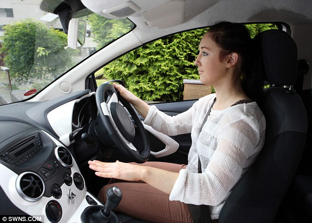 Cool rider: Drivers can adjust their air conditioning by raising and lowering their hand above the gear stick