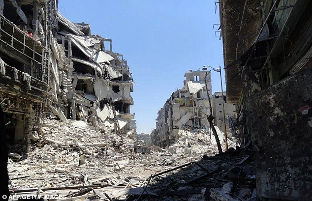 Scene of destruction: The Juret al-Shayah district of the central city of Homs lies in a state of ruin today