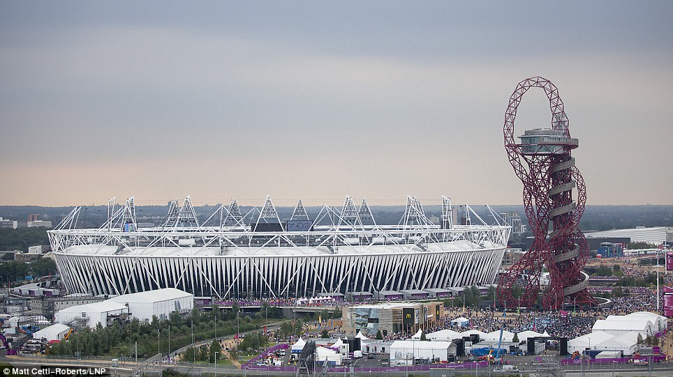 Crowds pour through the Olympic Park as audience members start to fill the stadium