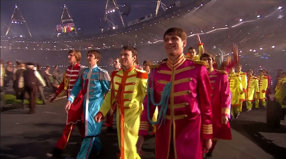 Actors dressed as the Beatles' from their Sergeant Pepper album marched around the stadium