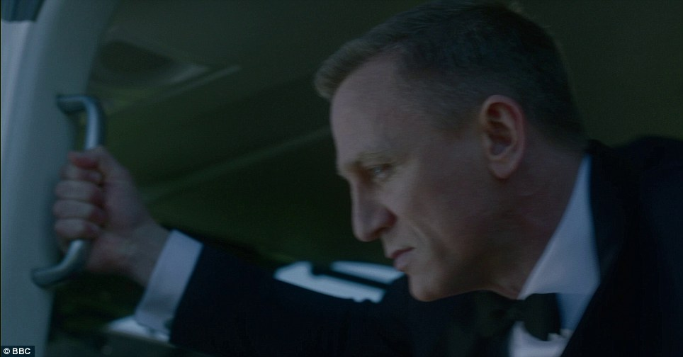 In a pre-filmed sketche, Daniel Craig, in character as James Bond, prepares to leap with the Queen