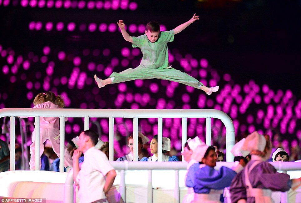 Children perform on trampolines as dancers play Great Ormond Street Children's Hospital staff