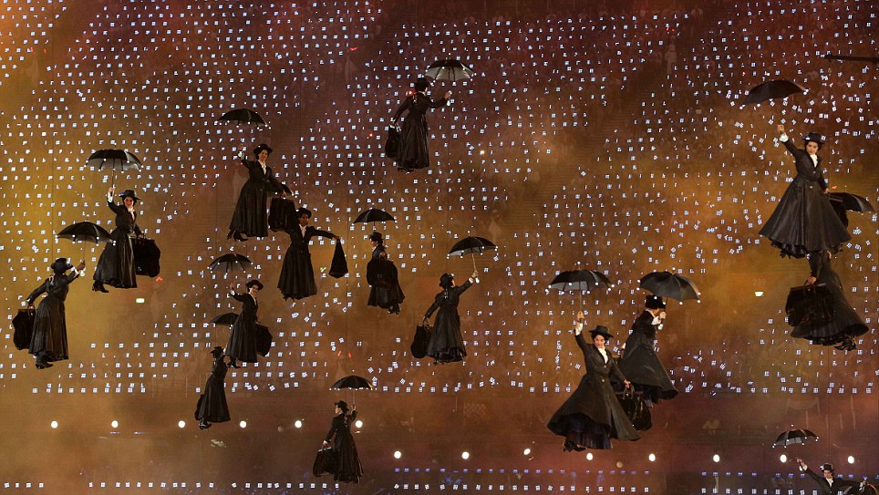 Actresses dressed as Mary Poppins float above the stadium, clinging onto umbrellas