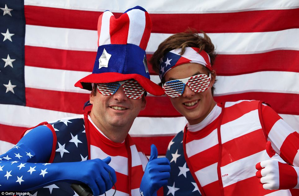 United States fans pose with their national flag outside the Olympic stadium
