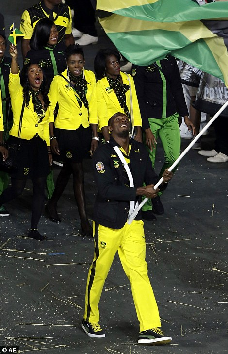 Usain Bolt carries the flag