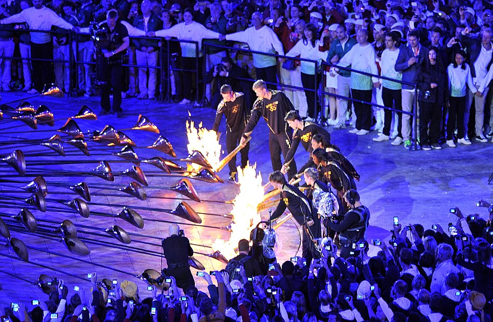 The athletes then lit copper metals, one to represent each nation taking part