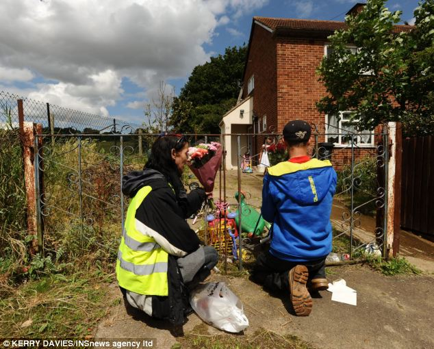 Friends and neighbours lay flowers at the spot where Ian Simpson suffered massive head injuries which lead to his death in hospital