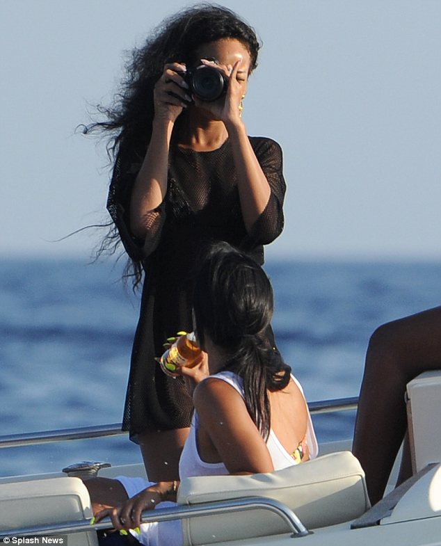 Picture perfect: The glamorous singer teased photographers as she was armed with her camera