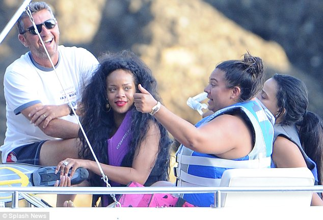 Fun with friends: Rihanna looked like she didn't have a care in the world as she cruised cross the water with her pals