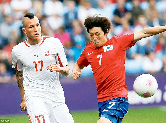 Disgraced: Switzerland defender Michel Morganella has been expelled from the London Olympics for directing an allegedly racist insult at South Koreans on Twitter. He is seen in action, left, during the match on Sunday