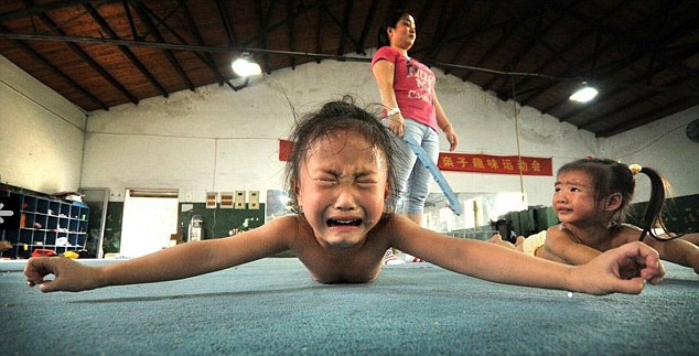 Winning at all costs: Children are put through their paces doing punishing exercises to toughen them up