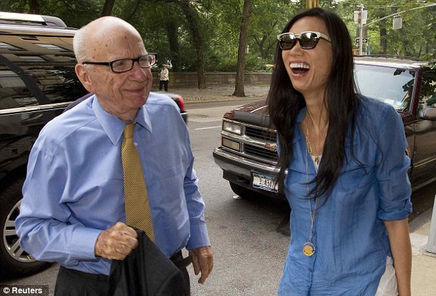 'Long-standing invitation': The News Corporation boss (left) and his wife Wendi Deng (right) are among a group of business leaders invited by Mr Johnson to attend a swimming final on Friday