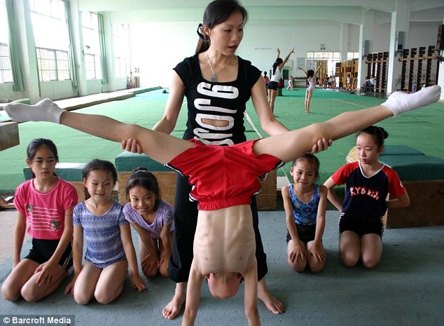 Stretchy: Gymnastic stars are known for starting at an incredibly early age, and this group of children appear no different as they battled to complete the demanding routines on bars, rings, and mats