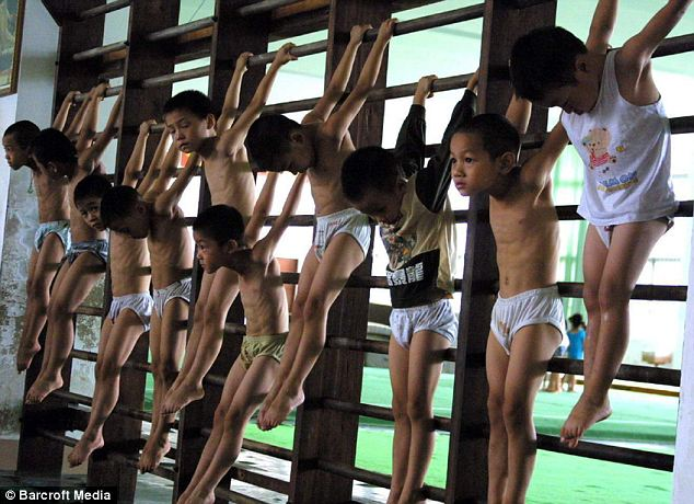 Ruthless: Boys and girls who looked no older than five or six-years-old were tasked with swinging on beams, hanging from pairs of rings and bounding across floor mats during the physically strenuous training sessions