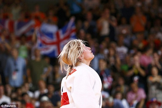 Britain's Gemma Gibbons looks to the heavens after her semi-final win. She whispered 'I love you mum' in tribute to her mother Jeanette, who died of leukaemia in 2004