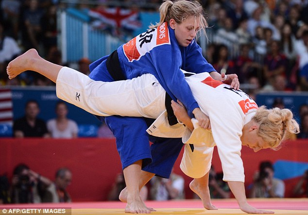 Gibbons (in the blue gown) attempts to throw her opponent Kayla Harrison in the final of the under 78kg judo