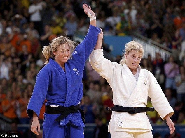 Gibbons (left) and Harrison salute the crowd at the end of their bout