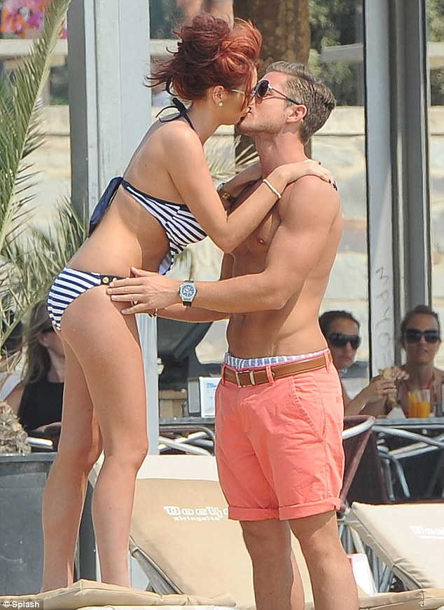 Can't get enough: at one point Amy even stood on her sun lounger to gain more convenient access to his face
