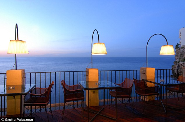 Atmospheric: The dimly-lit tables for two along the water's edge offer the most romantic seats in the house