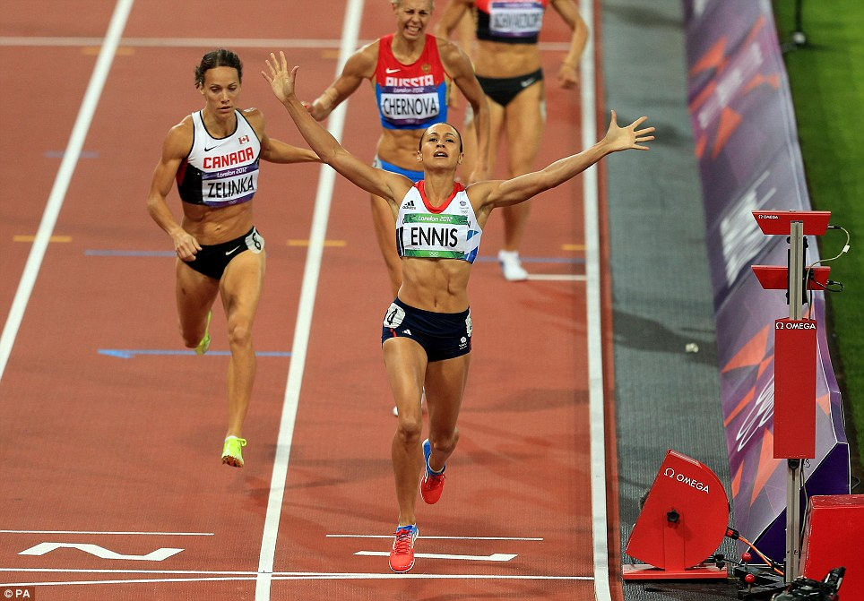 Golden girl: Jessica Ennis clinches the Olympic heptathlon title after a storming 800m that had the whole nation cheering her on