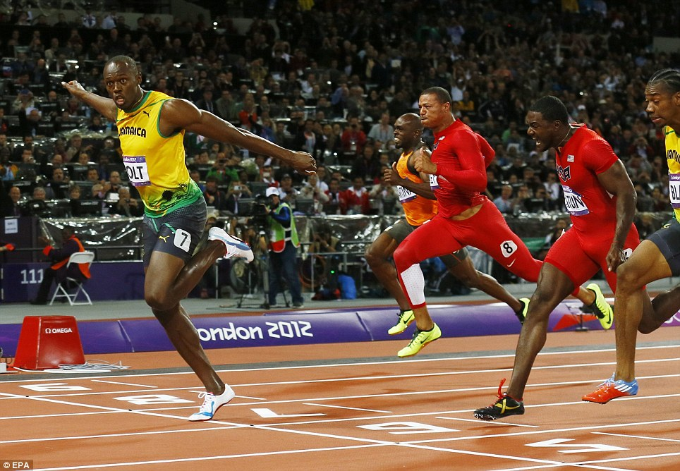 Champion again: Jamaica's Usain Bolt crosses the finish line to win gold in the men's 100-metre final in the Olympic Stadium in London