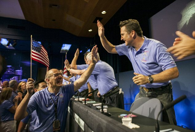 High five: Curiosity team member Miguel San Martin, Chief Engineer, Guidance, Navigation, and Control at Jet Propulsion Laboratory, left, celebrates with Adam Steltzner, MSL entry, descent and landing (EDL) worker.