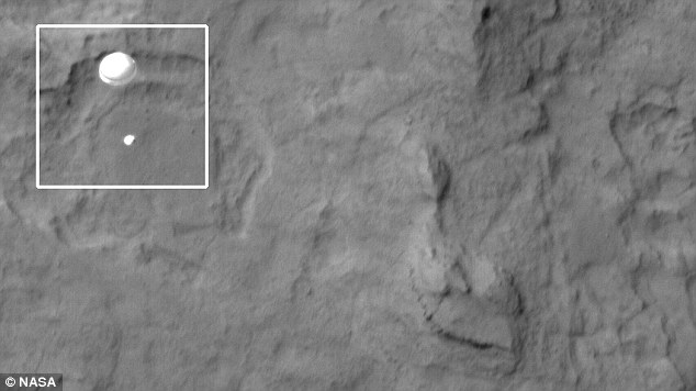 Nasa's HiRise telescope captures the martian rover's descent onto the red planet. Here, the parachute is clearly visible.