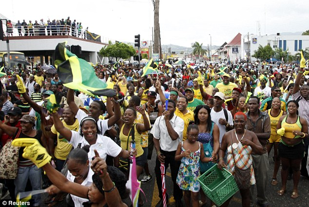 Jamaica came to a standstill as thousands poured out onto the streets to watch the race on large screens