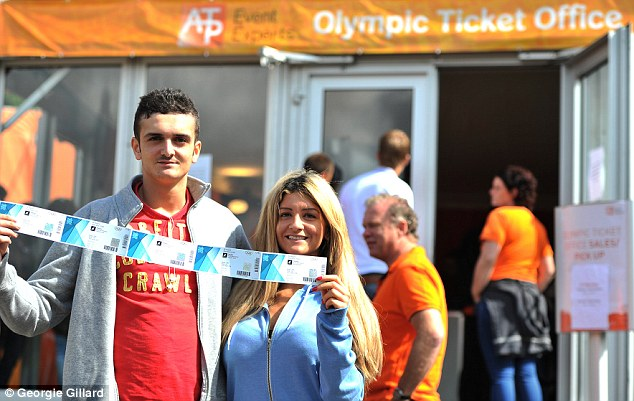 Success: Chris Friend and Jessica Friend from Berkshire, pose with hockey tickets after queuing at Holland House in Alexandra Palace from 5:45