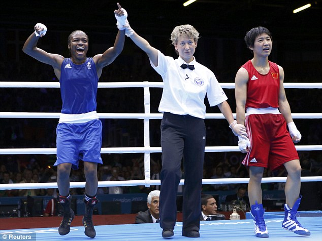 Jumping for joy: Adams was all smiles after her stunning victory in the flyweight final